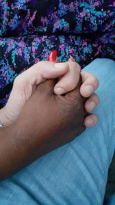 Female_black_and_male_white_hand_(holding,_adult)